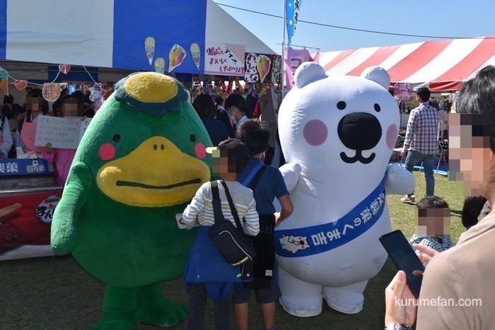 久留米市のイメージキャラクター「くるっぱ」と久留米市に本社を置く丸永製菓㈱のマスコットキャラクター「くま吉」